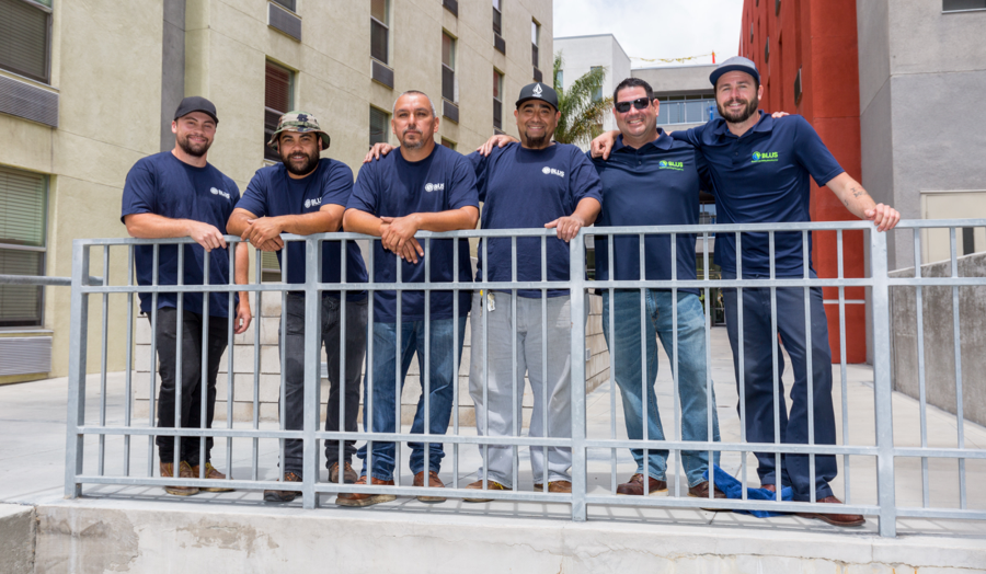 The BLUS crew bringing energy-saving upgrades to Island Village apartments.