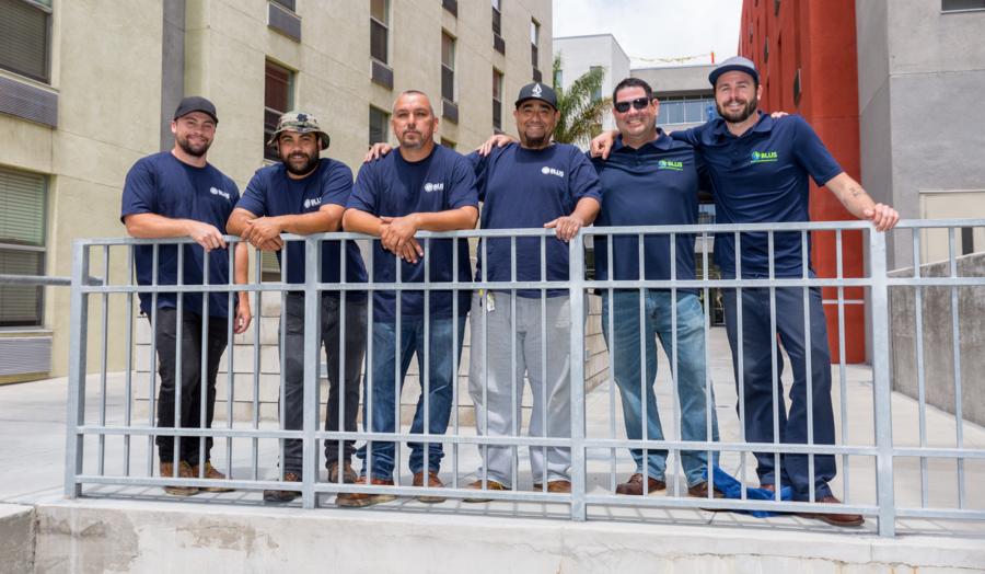 The BLUS crew bringing energy-saving upgrades to Island Village apartments.