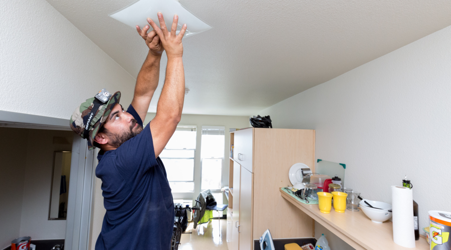 Bobby Zimmer replaces light fixture with an energy-efficient LED.
