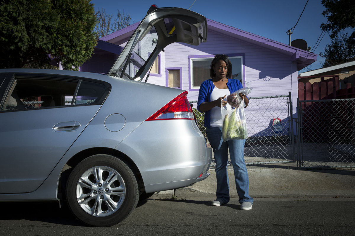 Kendra Tramiel photographed in Richmond, CA on November 4, 2016 with her 2010 Honda Insight.