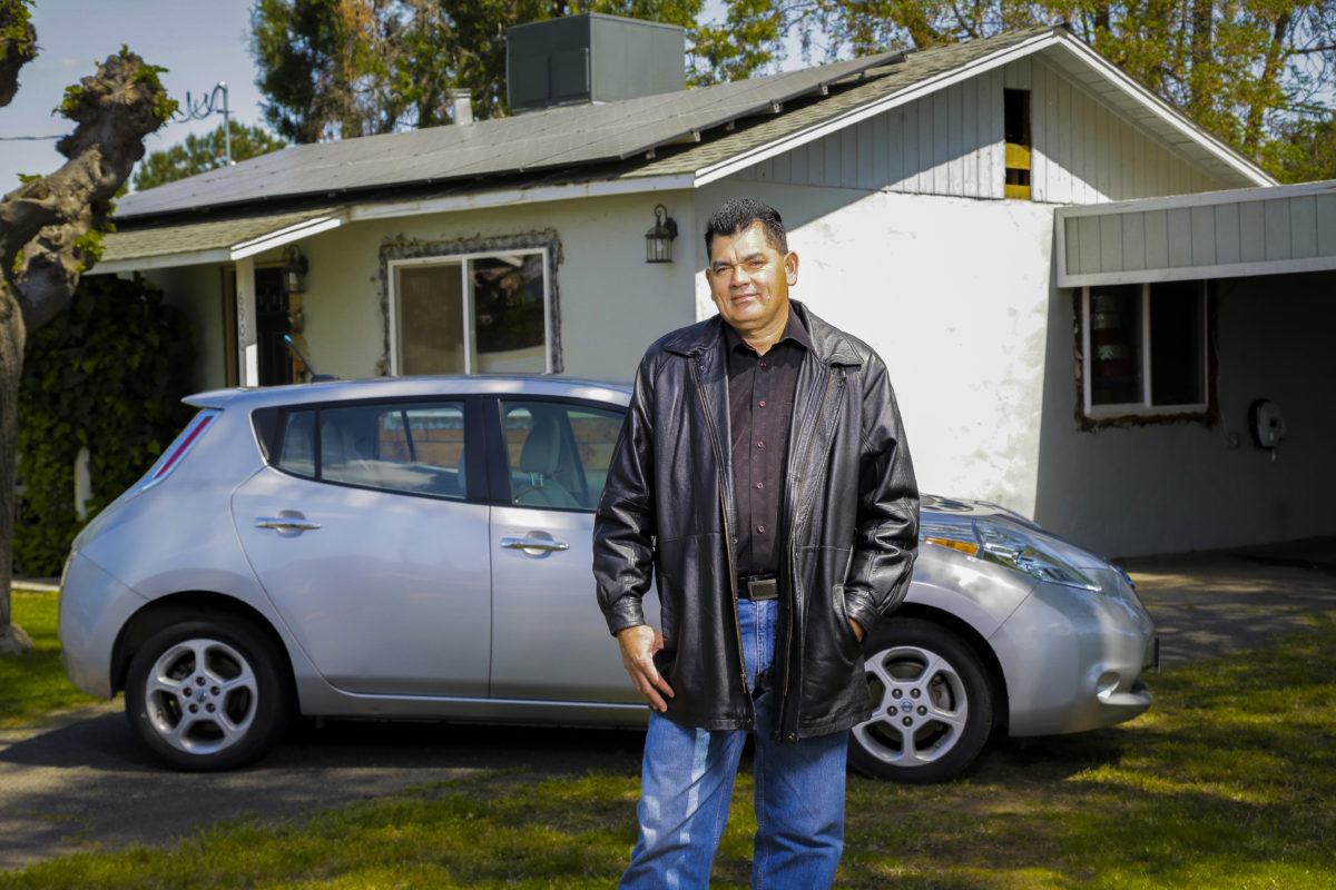 Fees paid by polluters helped Efrain buy an electric vehicle and charge it with solar power.